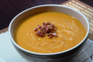 Butternut Squash soup with Pancetta bacon in a bowl