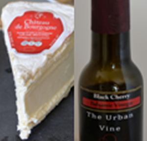 a wedge of Chateau de Bourgogne cheese with a bottle of cherry balsamic vinegar