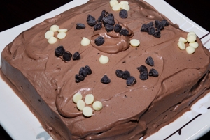 Chocolate cake with chocolate whipped cream icing and chocolate chips