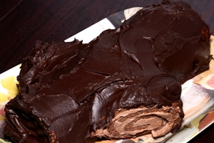 a chocolate log roll on a small platter