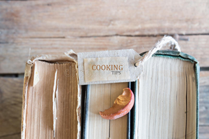 three old books that are designated cooking tips