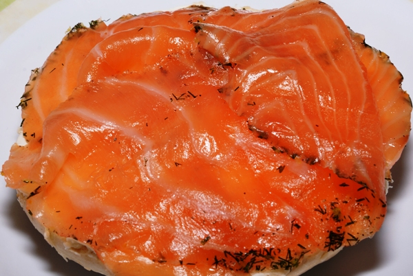 an open face bagel with Gravlax and cream cheese