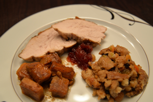 Thanksgiving dinner; roast turkey, sweet potatoes, stuffing, cranberry sauce