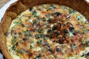 a 6 inch Wild Mushroom, Bacon, Spinach, Leek & Gruyére Cheese Quiche